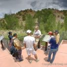 Tourists learning about rock formations from Colorado Jeep Tour guide