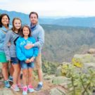 family posing for photo above Royal Gorge Colorado Jeep Tours