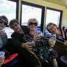 Ladies drinking wine on trolley