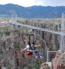 male enjoying zip line over Royal Gorge Colorado Jeep Tours
