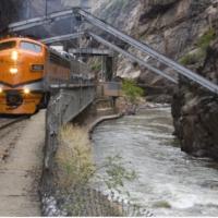 Royal Gorge Train travels along the Arkansas River under the hanging bridge Royal Gorge Canon City Colorado