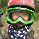 young boy wearing helmet and goggles is ready for his Play Dirty ATV ride Royal Gorge Canon City Colorado