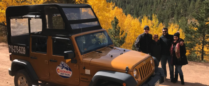 group of four pose during Colorado Jeep tour during fall color changes in Canon City Colorado