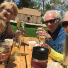 Four friends take a selfie at a wine tasting event in Canon City Colorado