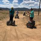four segway riders enjoy the dirt road Royal Gorge Canon City Colorado