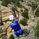 woman ziplines with mountain views at Captain Zipline park Royal Gorge Canon City Colorado