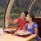 mom and daughter looking at scenery from dome car in train Colorado Jeep Tours